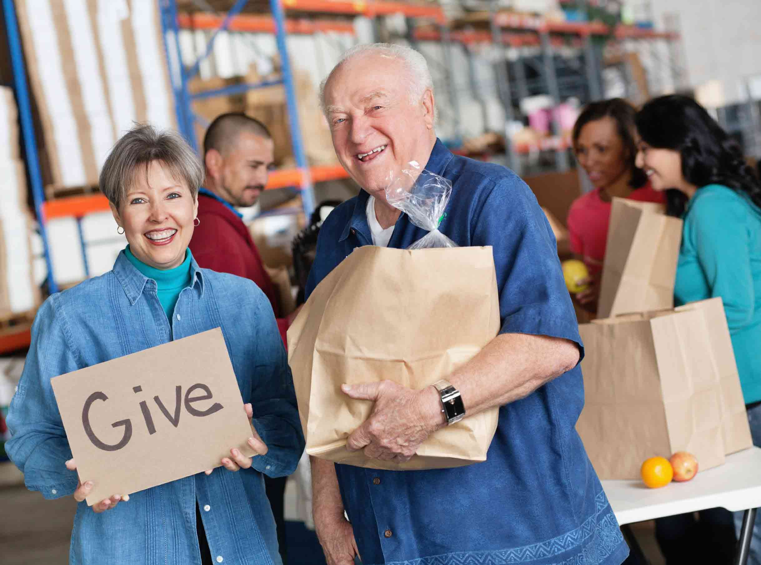 Older Couple Giving Food at Food Drive