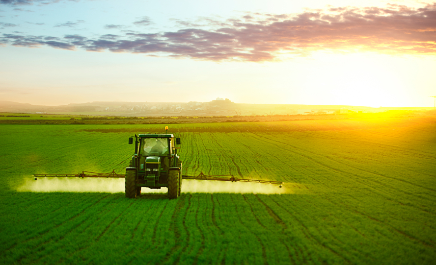 Image of a tractor watering a field