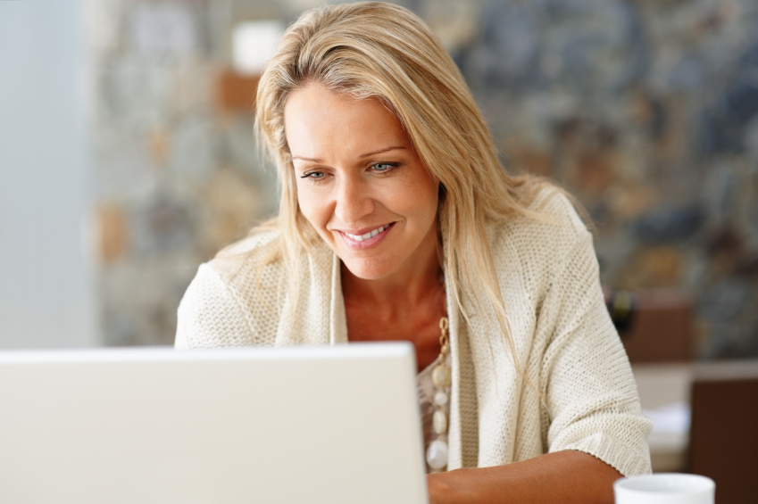 Lady using computer for Online Banking