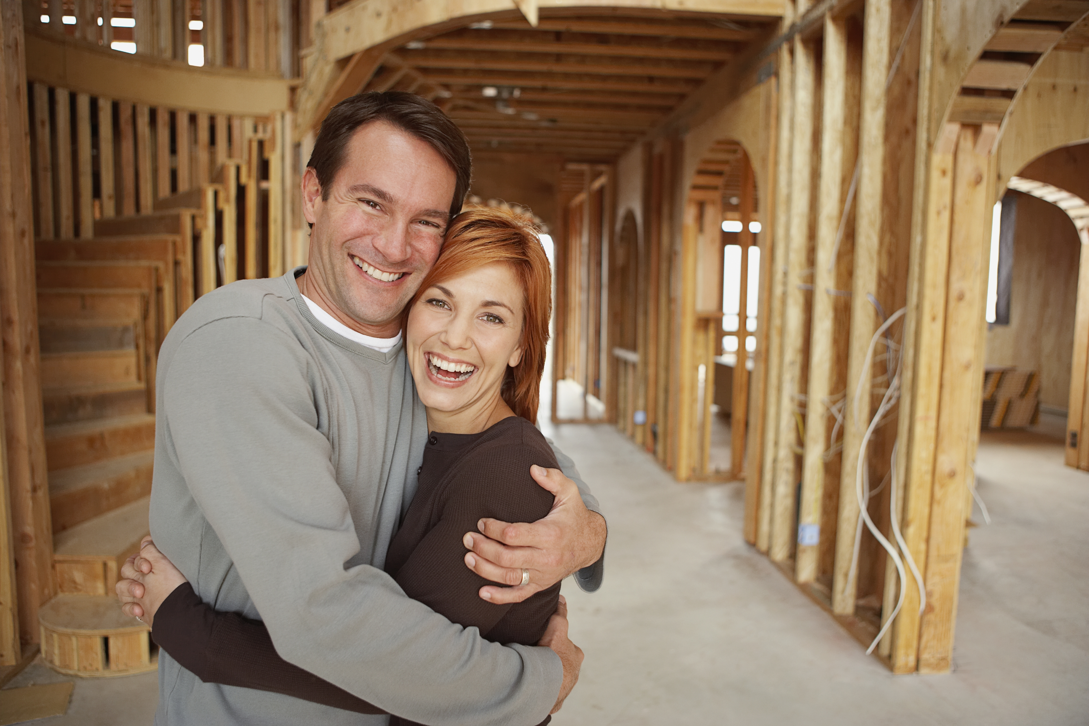 Couple Standing in House Under Construction
