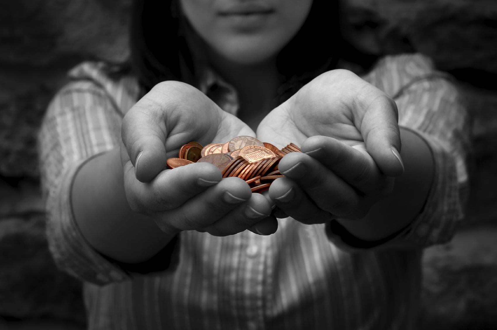 Hands holding pennies